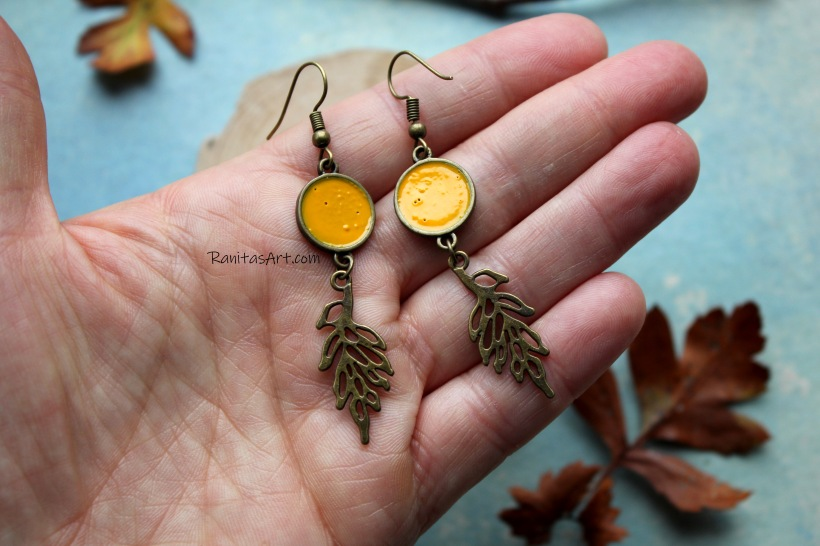 Earrings metal leaves, in old gold color, frame with enamel color yellow